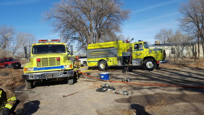 Firefighters respond to the scene of a house fire in Shiprock on Tuesday that claimed the life of an unidentified man.