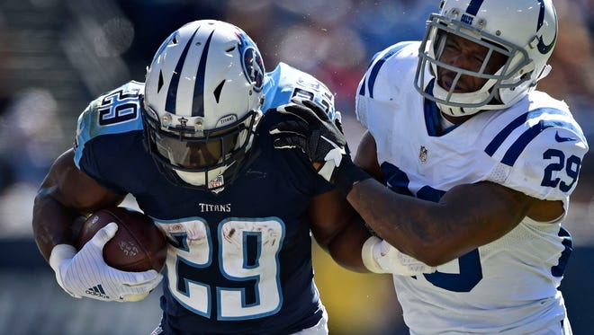 Titans running back DeMarco Murray (29) is tackled by Colts strong safety Mike Adams (29)at Nissan Stadium Sunday, Oct. 23, 2016, in Nashville, Tenn.