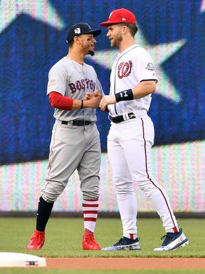 Bryce Harper talks with Mookie Betts before the game at Nationals Park.