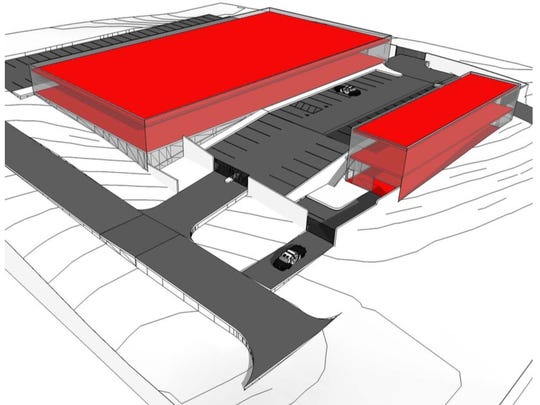 A draft massing diagram shows how a new police/court facility might look at the New Brooklyn Road site.