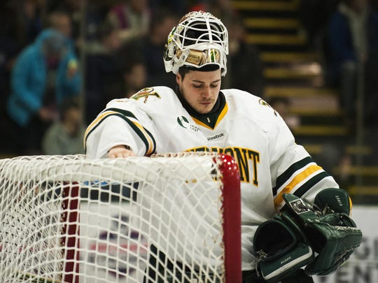 Catamounts goalie Mike Santaguida (1) reacts after a Maine goal during the Hockey East quarterfinal men's hockey game between the Maine Blackbears and the Vermont Catamounts at Gutterson Fieldhouse last season.