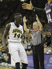 Iowa guard Peter Jok reacts after hitting his third 3-pointer in a row during Sunday's win over Northwestern.