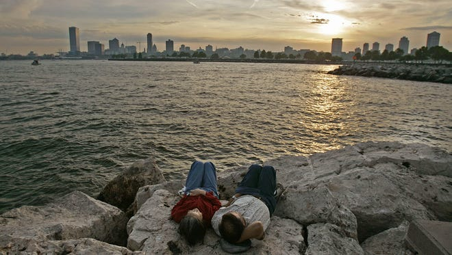 A Milwaukee couple takes in the skyline at Lake Michigan. The cost to tap into the Great Lakes water supply would cost billions, an expert says.