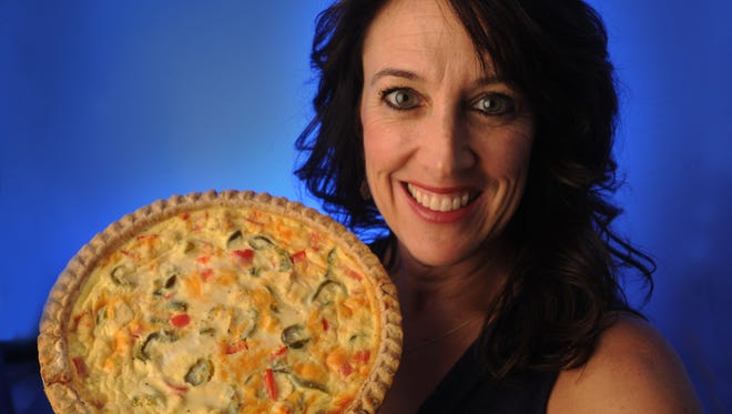 Cook du jour Crista Fisher poses with her quiche.