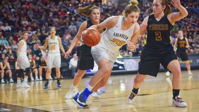 Aberdeen's Paiton Burckhard goes against Harrisburg defense during the game Saturday, March 17, at the Denny Sanford Premier Center in Sioux Falls.
