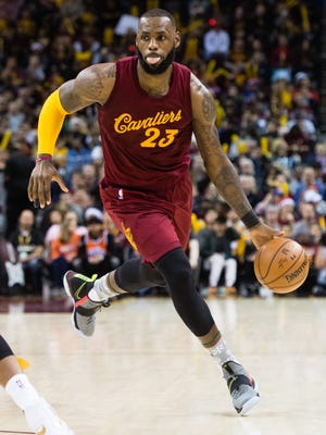 LeBron James #23 of the Cleveland Cavaliers drives drives to the lane during the second half against the Golden State Warriors at Quicken Loans Arena on December 25, 2016 in Cleveland, Ohio. The Cavaliers defeated the Warriors 109-108.