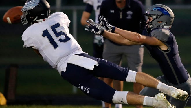 Menasha High SchoolÕs Cole Popp intercepts a pass meant for Xavier High School's Tyler Farr Friday, Sept. 1, 2017, in Appleton, Wis.Danny Damiani/USA TODAY NETWORK-Wisconsin