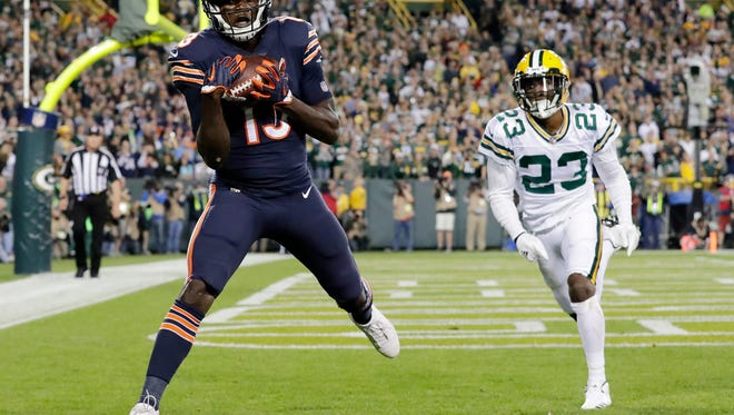 Chicago Bears wide receiver Kendall Wright (13) catches a touchdown pass beyond the coverage of Green Bay Packers cornerback Damarious Randall (23) in the second quarter on Thursday, Sept. 28, 2017 at Lambeau Field.