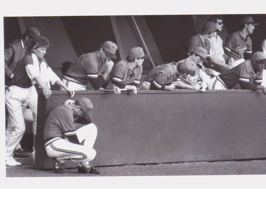 UL trainer Kelley Coley, left, and head coach Gene Shell get through a tense moment during the 1985 season. By that time, the dugout wasn't yet sunken, but had been covered since the first few years of Tigue Moore Field.