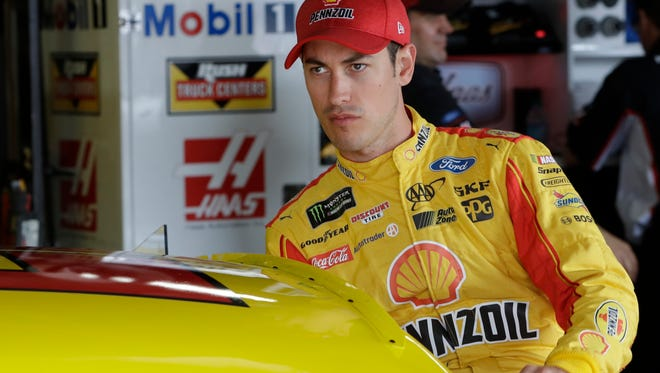 Joey Logano enters his car before a practice session, Saturday, June 17, 2017, for the NASCAR Sprint Cup series auto race in Brooklyn, Mich.