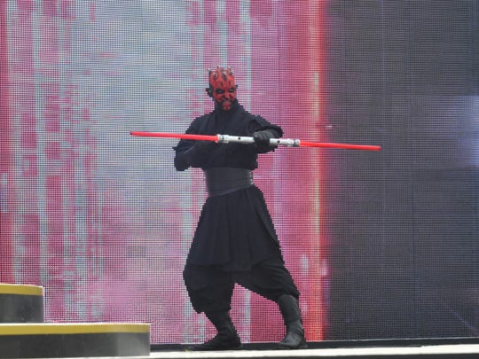 "Darth Maul takes the stage during the new outdoor show, ""Star Wars: A Galaxy Far, Far Away,"" which can be seen at Disney's Hollywood Studios in Orlando."