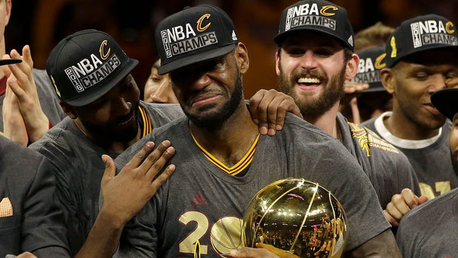 Tears of joy. Cleveland Cavaliers forward LeBron James, center, celebrates with teammates after Game 7 of basketball's NBA Finals against the Golden State Warriors in Oakland, California, Sunday, June 19, 2016. The Cavaliers won 93-89.