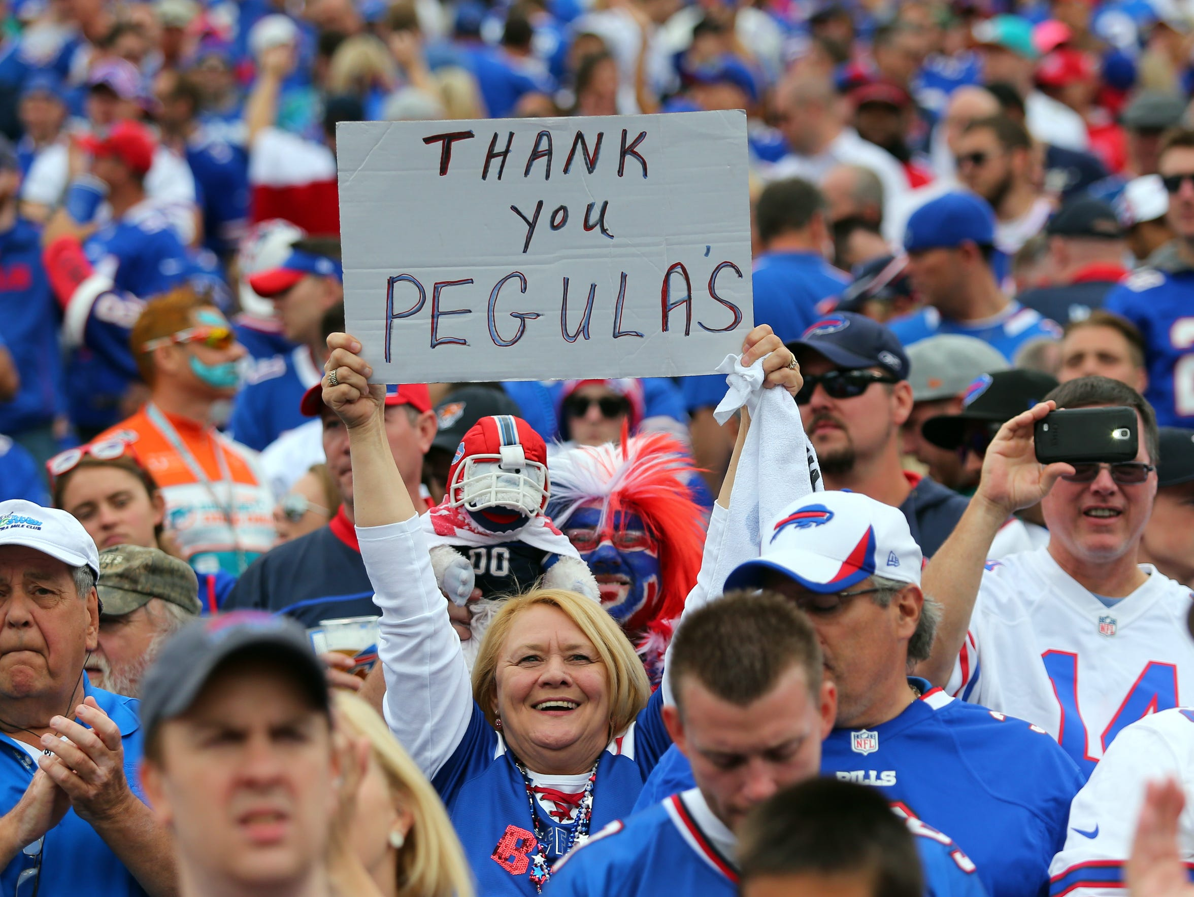 A fan holds a sign thanking then-prospective Buffalo