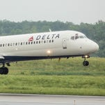 A Delta Boeing 717 lands at a rainy Detroit Metropolitan Wayne County Airport on June 27, 2015.