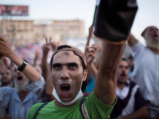 Egypt police delay threat to evict pro-Morsi sit-ins