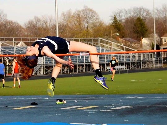 Jenna Rogers clears the bar in an earlier competition for Rutherford.