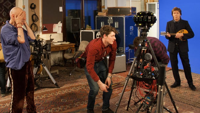 "Paul McCartney, far right, waits as Jaunt Studios techs set up another shot for a mini-documentary series promoting the singer's new retrospective album, ""PURE McCartney."""