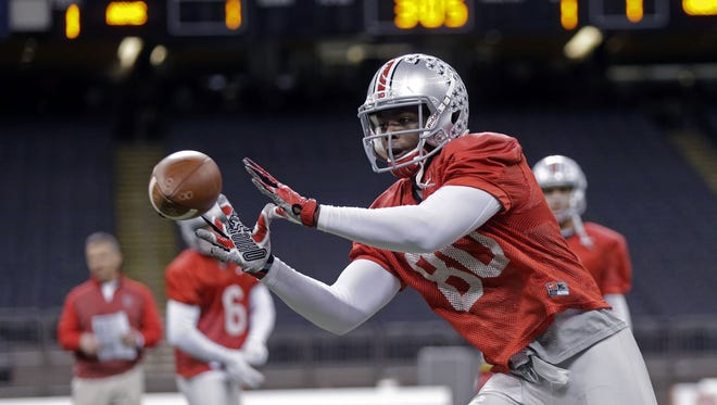 Ohio State wide receiver Noah Browngoes through drills during practice at the Mercedes-Benz Superdome in New Orleans on Dec. 29, 2014.