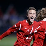 U of L's Daniel Keller celebrates with teammate Greg Cochrane after a goal in a 2012 NCAA tournament game at Cardinal Park.