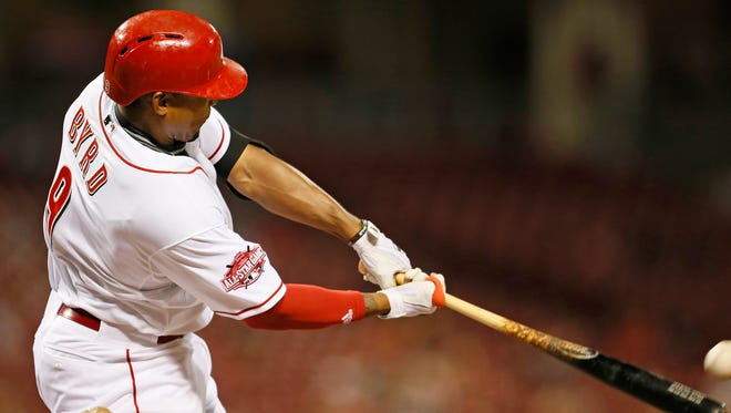 Reds left fielder Marlon Byrd hits a go-ahead solo home run during the bottom of the eighth inning Thursday against the Giants.