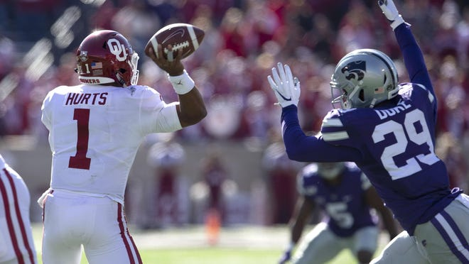 Kansas State defensive end Khalid Duke pressures Oklahoma quarterback Jalen Hurts during their game last year. Duke will pair with Kansas State's Wyatt Hubert to form a formidable pass-rushing duo this season for the Wildcats.