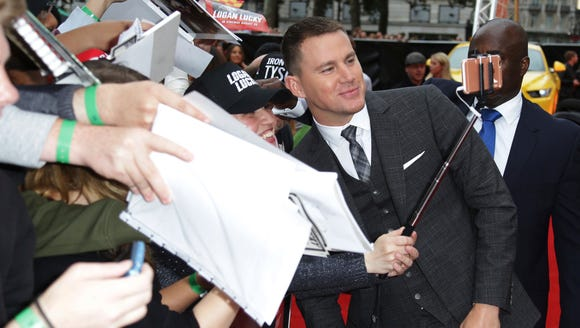 Channing Tatum smiles for photos with fans.
