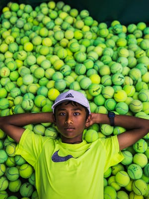 July 25, 2017 - Kartik Mandla, 11, poses for a portrait at the Eldon Roark Tennis Center in Whitehaven on Tuesday. Mandla, a rising tennis star from Collierville, is one of only 24 youths around the nation selected to train with the United States Tennis Association.