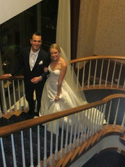 Groom and bride Tyler Daniel and Lila Nelson walk