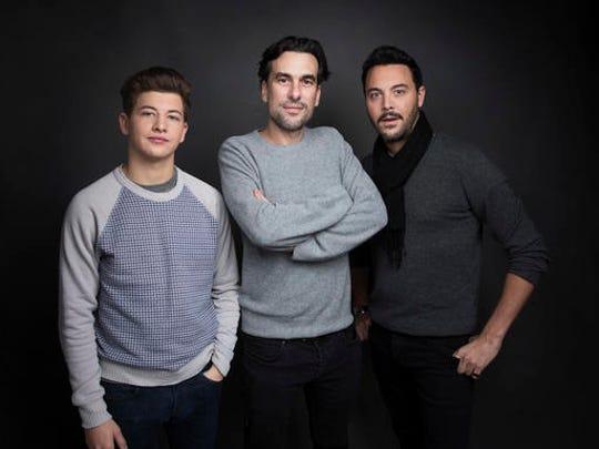 """Actor Tye Sheridan, from left, director Alexandre Moors and actor Jack Huston pose for a portrait to promote the film, """"The Yellow Birds"""", at the Music Lodge during the Sundance Film Festival on Sunday, Jan. 22, 2017, in Park City, Utah."""