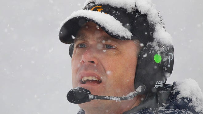 Grand Ledge coach Matt Bird looks out from the sideline against Romeo during their MHSAA semifinal game Saturday, Nov. 21, 2015, in Brighton, Mich. Grand Ledge fell 48-21.
