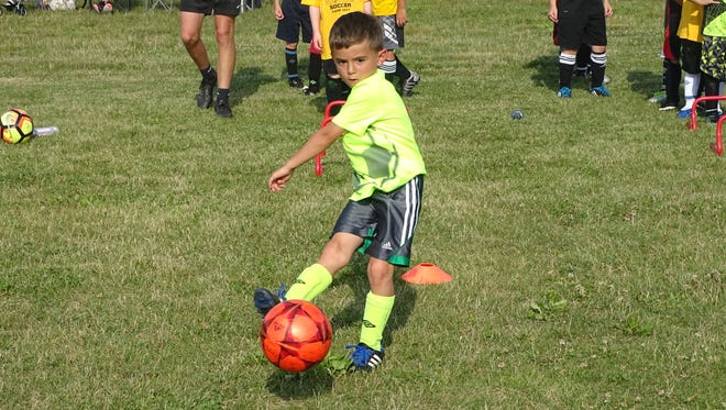 Samuel Pastoria, 5, practices his shooting Thursday during Watkins Memorial's boys soccer camp.
