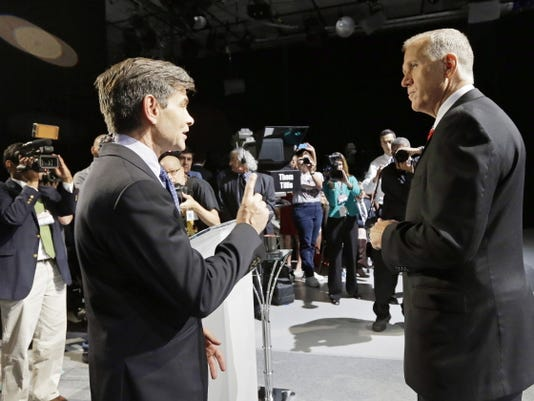 """FILE - In this Oct. 7, 2014 file photo, moderator George Stephanopoulos, left, and North Carolina Republican Senate candidate Thom Tillis speak prior to a live televised debate between Tillis and Sen. Kay Hagan, D-N.C. at UNC-TV studios in Research Triangle Park, N.C. Stephanopoulos will not moderate a Republican presidential debate next winter, part of the fallout from reports that the network's top political anchor contributed 75,000 over a three-year period to the Clinton Foundation. The co-host of """"Good Morning America"""" and host of the Sunday morning public affairs program """"This Week"""" earlier had apologized for not disclosing his contributions to his employer and viewers. Stephanopoulos voluntarily stepped away from the Feb. 6 debate, said ABC News spokeswoman Heather Riley on Thursday, May 14."""