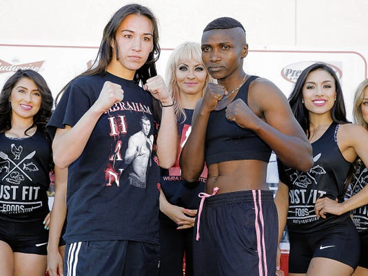El Pasoan Jennifer Han squares off against opponent Fatuma Zarika of Nairobi, Kenya, during weigh-ins held Friday afternoon. Han and Zarika will fight for the vacant IBF InterContinental featherweight title Saturday night at the El Paso County Coliseum in a 10-round fight.