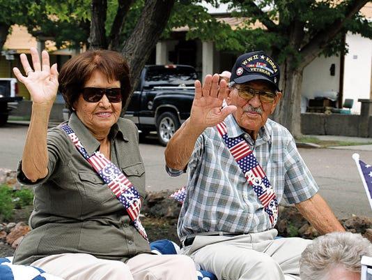"Bill Armendariz - Headlight Photo   World War II and Korea veteran Florentino ""Lilo"" Pacheco and his wife Juanita rode as grand marshals for this year's parade."