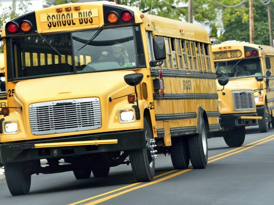 Buses leave Benjamin Chambers Elementary School after classes on Monday. A committee is looking into redistricting due to overcrowding at some elementary schools.