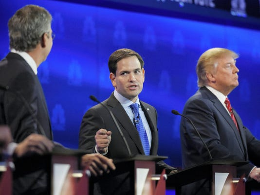 Marco Rubio, center, and Jeb Bush, left, argue a point as Donald Trump, looks on during the CNBC Republican presidential debate at the University of Colorado, Wednesday, Oct. 28, 2015, in Boulder, Colo. (AP Photo/Mark J. Terrill)