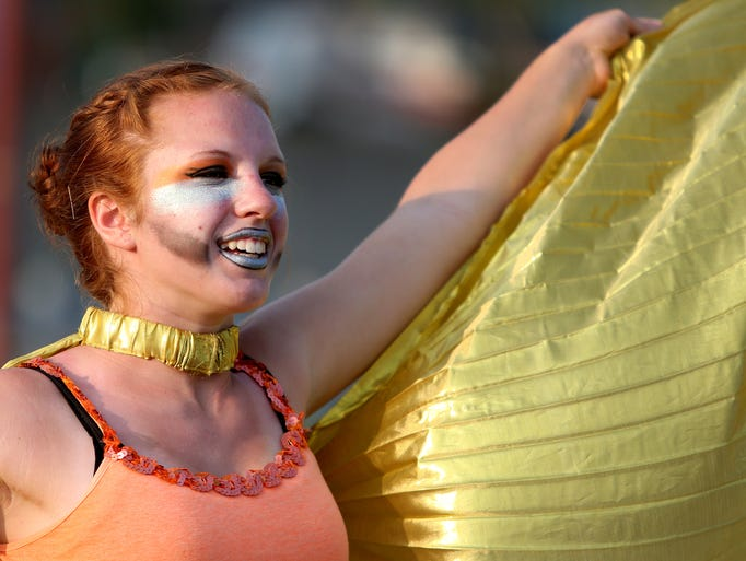 Jacqueline Habzansky, a Hagerstown sophomore, warms up with the color guard during the Music Travel Consultants Band Day Contest finals at the Indiana State Fair in Indianapolis on Saturday, Aug. 2, 2014.