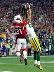 Green Bay Packers wide receiver Jeff Janis (83) makes a catch for a touchdown as Arizona Cardinals cornerback Patrick Peterson (21) defends during the second half of an NFL divisional playoff football game, Saturday, Jan. 16, 2016, in Glendale, Ariz.