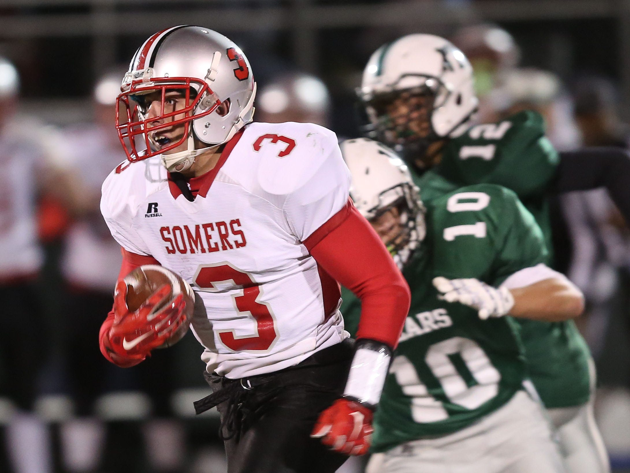 Somers' Matthew Pires (3) breaks away from Brewster's Rob Peifer (10) on a first half touchdown run during the Section 1 Class A semifinals at Brewster High School Oct. 28, 2016.