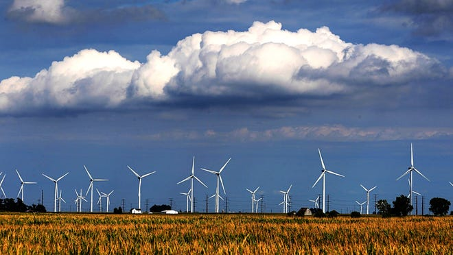 The Indiana skyline north of Lafayette is dotted with hundreds of windmills. The turbines provide wind energy as an alternative to fossil fuels. (Mike Fender / The Star)
