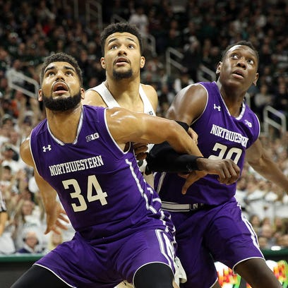 Michigan State's Kenny Goins fights for position with