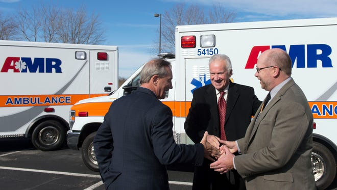 """AMR Regional Director Chris Blach, right is greeted by Knox County Commissioners Bob Thomas, left, and Ed Brantly after a news conference announcing the rebranding of Rural Metro ambulances to AMR at the Rural Metro headquarters in West Knox County on Thursday, December 8, 2016. American Medical Response acquired Rural Metro more than a year ago. """"AMR has invested a huge amount of time and energy and financial support to our Knox (County) operation."""" Said Blach. """"We've hired over 100 EMT's and paramedics into the system and it's really a whole different operation than we were a year ago."""""""