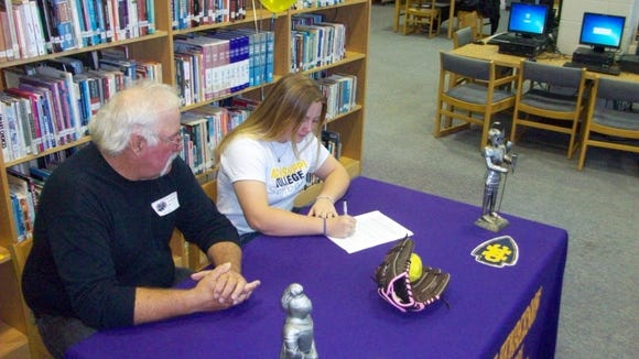 North Henderson senior Cheyenne Mathews signs to play softball for Mississippi College.