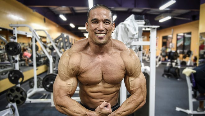 Bodybuilder Dan Munoz offers a free gun show at the Paradise Fitness Center in Dededo on Nov. 4.