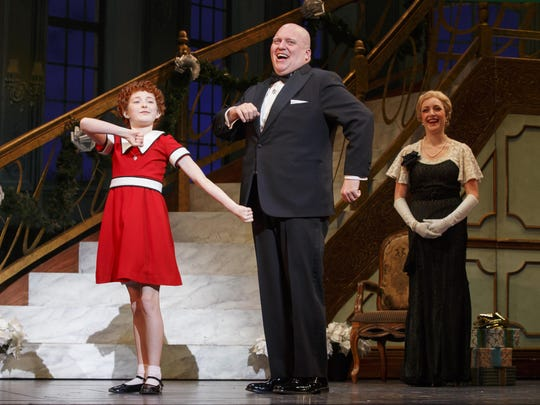 "Heidi Gray, Gilgamesh Taggett and Chloe Tiso star in the national touring production of ""Annie."""