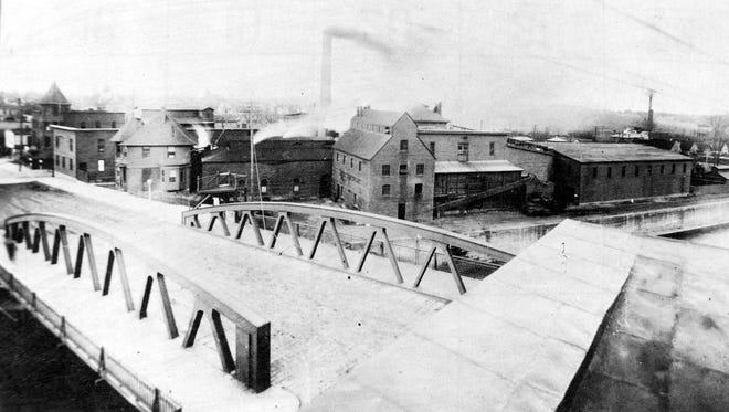 This photo, circa around 1914, is the scene looking northeast over the Main Street lift bridge. The fruit packing operations can be seen along the canal, on the former site of the DeLand factory.