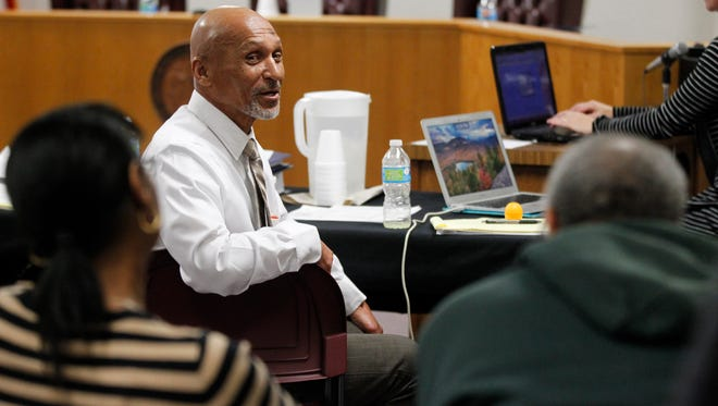 Joseph Sledge, center, talks with his sister Barbara and brother Oscar during a break as a three-judge panel takes up his claim of innocence in Whiteville, N.C., on Friday, Jan. 23, 2015. The panel planned to consider whether Sledge was wrongfully convicted nearly four decades ago of killing a mother and daughter in North Carolina. (AP Photo/The News & Observer, Ethan Hyman)
