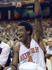 Chris Porter reacts on the bench during the second half in Auburn's 93-61 win over rival Alabama in the 1999 SEC Tournament at the Georgia Dome in Atlanta.