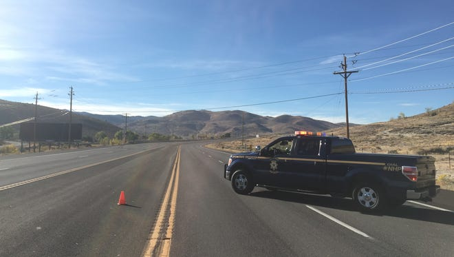 A Nevada Highway Patrol vehicle is seen closing S. Virginia St. south of Mt. Rose Highway in Reno on Oct. 15, 2015.