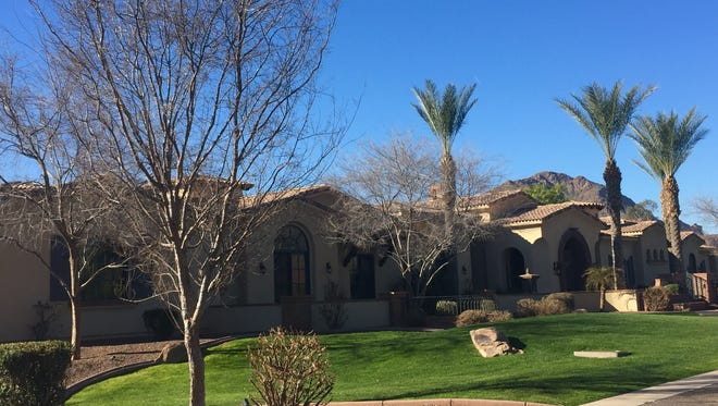 Doctors Rohit and Priti Sud bought a $3,386,800, six-bedroom house in Paradise Valley. The 2009 house offers 9,491 square feet, a home theater, wood-grained library, Camelback Mountain views and a pool and yard with 16 fountains and fire features.